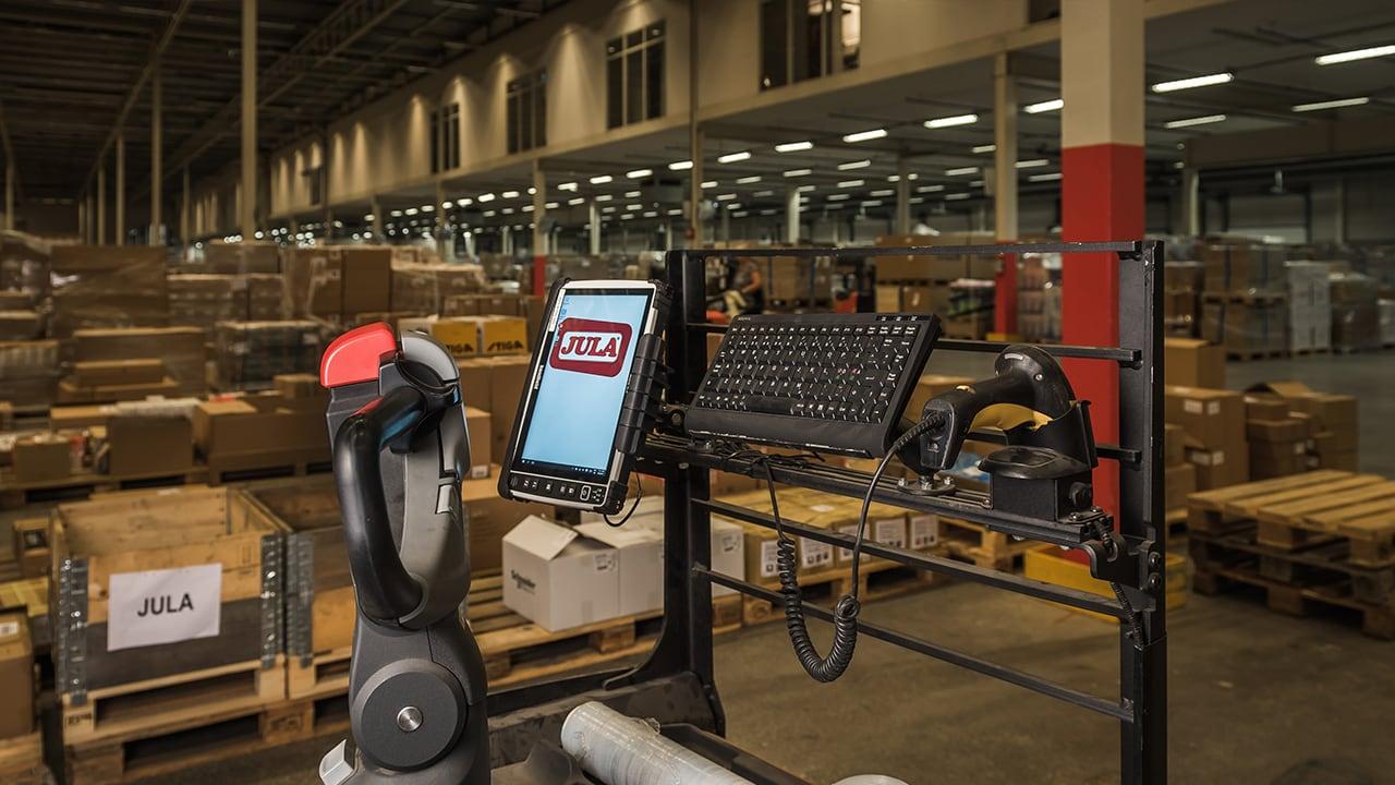 Handheld Algiz 10X docked in truck at warehouse