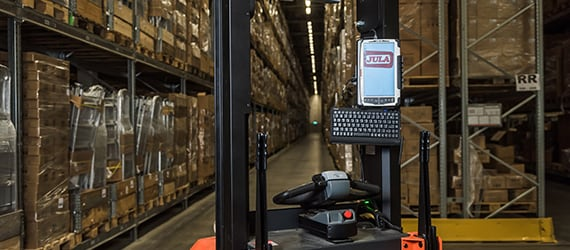 Handheld Algiz 10X docked in truck at warehouse