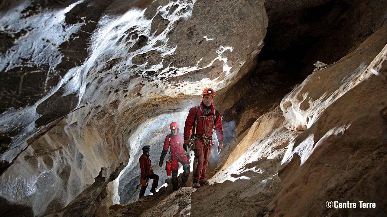 Cave divers inside a cave