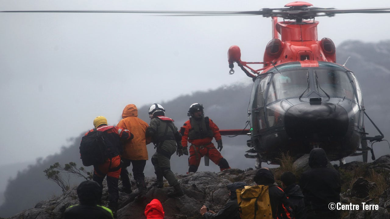 Researchers boarding a helicopter