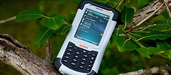 Handheld Nautiz X7 in tree