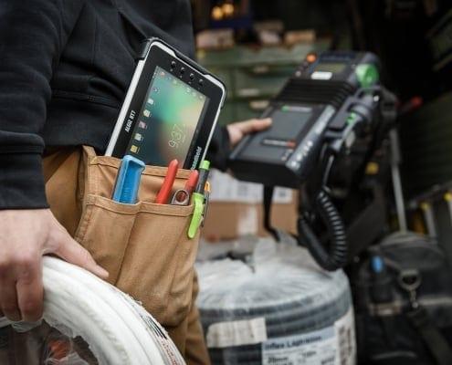 handheld algiz rt7 in worker's pocket