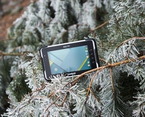 handheld algiz rt7 in a snowy tree