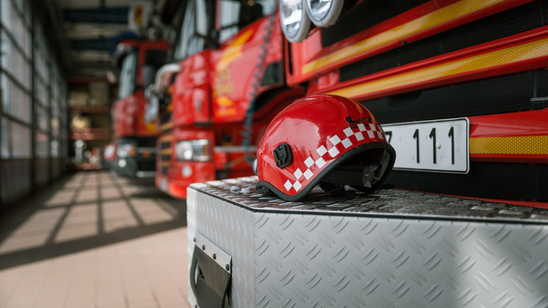 Fire-trucks lined up at a fire brigade