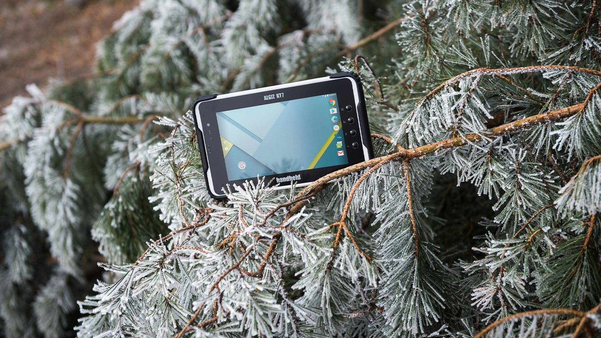 handheld algiz rt7 in winter tree