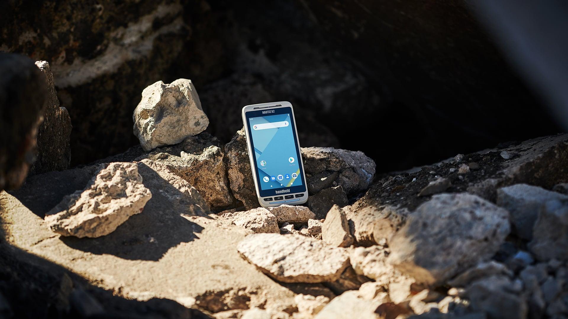 handheld nautiz x2 standing on rocks